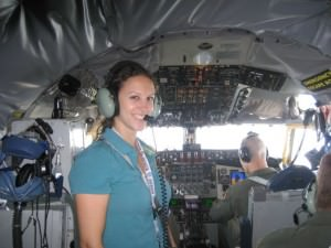 Lisa Mangiafico getting ready to take her seat in the cockpit of a KC-135 Military Stratotanker for take off.